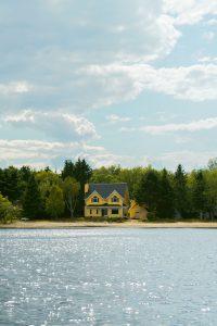 yellow-cottage-on-lake